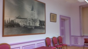 In the mayor's conference room, an old illustration of Saint Pierre